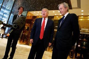 President-elect Donald Trump, accompanied by French businessman Bernard Arnault, speaks with reporters after a meeting at Trump Tower in New York, Monday, Jan. 9, 2017.
