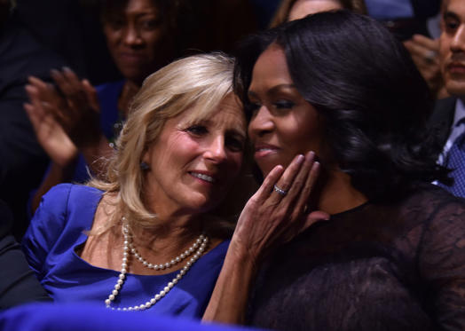 Slide 3 de 13: US first lady Michelle Obama (R) and the Vice Presidents wife, Jill Biden, hug as US President Barack Obama speaks during his farewell address in Chicago, Illinois on January 10, 2017. Barack Obama closes the book on his presidency, with a farewell speech in Chicago that will try to lift supporters shaken by Donald Trump's shock election. / AFP / Nicholas Kamm (Photo credit should read NICHOLAS KAMM/AFP/Getty Images)