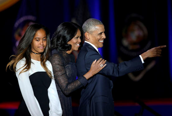 Slide 2 de 13: President Barack Obama points as he is joined by First Lady Michelle Obama and his daughter Malia Obama after giving his presidential farewell address at McCormick Place in Chicago, Tuesday, Jan. 10, 2017.