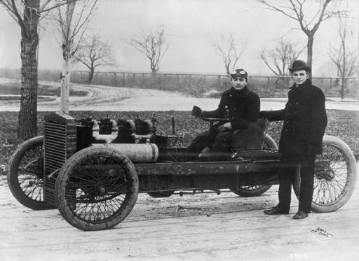 Slide 1 of 10: (Original Caption) Henry Ford standing beside his famous racer 999 with Barney Oldfield at the tiller. Both Ford and Oldfield drove this four-cylinder, 80 horsepower racer to world speed records. On January 1, 1904 on the ice of Lake St. Clair, Ford set