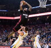 Miami Heat forward James Johnson (16) dunks the basketball against Golden State Warriors guard Stephen Curry (30) during the first quarter at Oracle Arena.