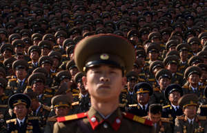 A North Korean soldiers stands before spectators during a mass military parade at Kim Il-Sung square in Pyongyang on October 10, 2015. North Korea was marking the 70th anniversary of its ruling Workers' Party.