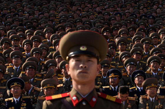 Dia 1 van 38: A North Korean soldiers stands before spectators during a mass military parade at Kim Il-Sung square in Pyongyang on October 10, 2015. North Korea was marking the 70th anniversary of its ruling Workers' Party.
