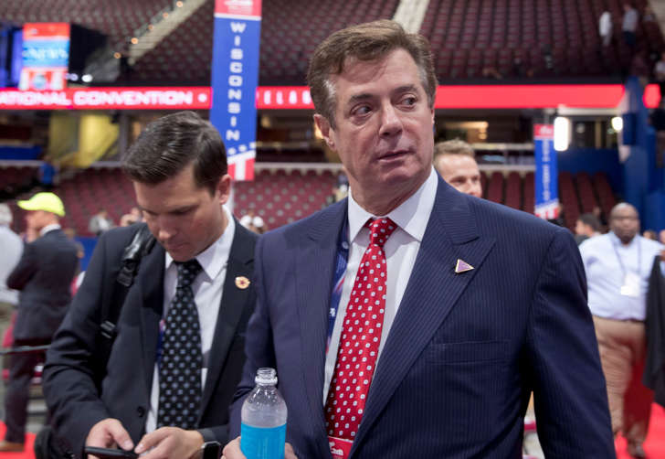 In this July 18, 2016, file photo, Trump campaign chairman Paul Manafort walks around the convention floor before the opening session of the Republican National Convention in Cleveland. Manafort resigned in wake of campaign shakeup and revelations about Ukraine work.