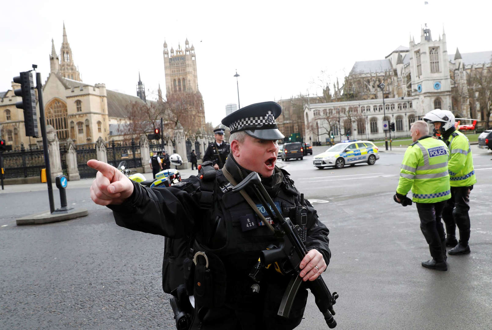 Slide 1 of 17: Armed police respond outside Parliament during an incident on Westminster Bridge in London, Britain March 22, 2017.
