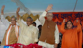 L.K. Advani, second right, senior BJP leaders Uma Bharati, right, Kalyan Singh, second left, and Murli Manohar Joshi wave to people during a public rally in Rae Bareilly, in the northern Indian state of Uttar Pradesh, Thursday, July 28, 2005.