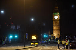 Police officers work at the scene after an attack on Westminster Bridge in London.