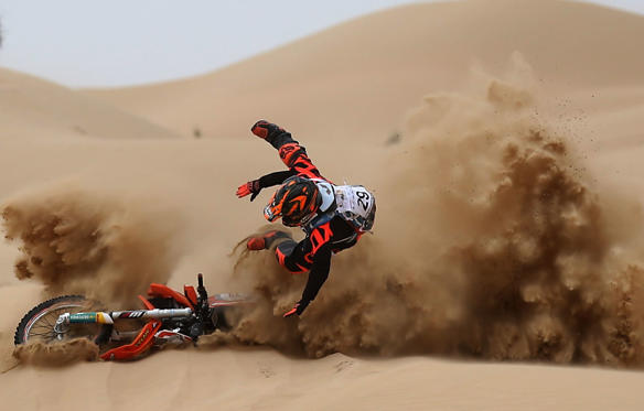 Slide 3 of 34: DUBAI, UNITED ARAB EMIRATES - MARCH 11:  Mohammed Anis of India crashes into the sand during day two of the Dubai International Bajaon March 11, 2017 in Dubai, United Arab Emirates.  (Photo by Francois Nel/Getty Images)