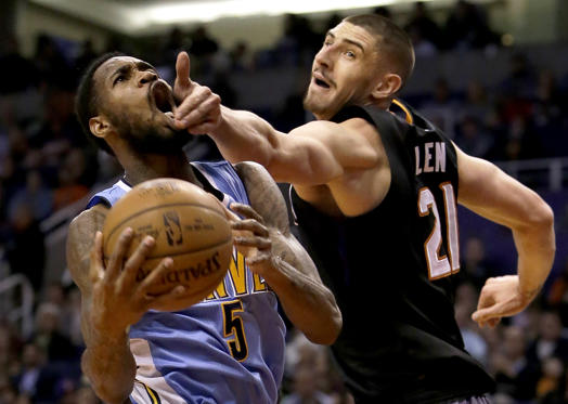 Slide 10 of 34: Denver Nuggets guard Will Barton (5) is fouled by Phoenix Suns center Alex Len in the first quarter during an NBA basketball game, Saturday, Jan. 28, 2017, in Phoenix. (AP Photo/Rick Scuteri)