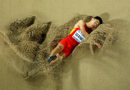 Slide 31 of 34: Wang Jianan of China competes in the men's long jump final during the 15th IAAF World Championships at the National Stadium in Beijing, China, August 25, 2015. REUTERS/Fabrizio Bensch TPX IMAGES OF THE