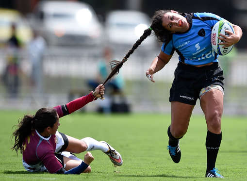 Slide 25 of 34: RIO DE JANEIRO, BRAZIL - MARCH 05: Maryoly Gamez of Venezuela battles for the ball against Victoria Rios of Uruguay during the International Womens Rugby Sevens - Aquece Rio Test Event for the Rio 2016 Olympics at Deodoro Olympic Park on March 6, 2016 in