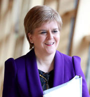 MSPs leave the chamber of the Scottish parliament after the sitting was suspende...