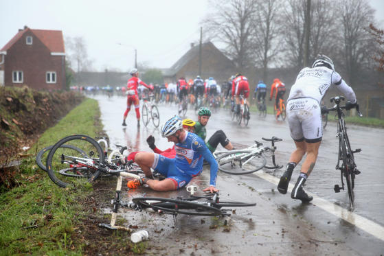 Slide 34 of 34: GHENT, BELGIUM - MARCH 01:  Riders crash in wet conditions during the Omloop Het Nieuwsblad on March 1, 2014 in Ghent, Belgium.  (Photo by Michael Steele - Velo/Getty Images)