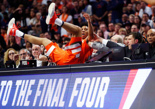 Slide 22 of 34: CHICAGO, IL - MARCH 27:  Malachi Richardson #23 of the Syracuse Orange falls off of the court in the second half against the Virginia Cavaliers during the 2016 NCAA Men's Basketball Tournament Midwest Regional Final at United Center on March 27, 2016 in