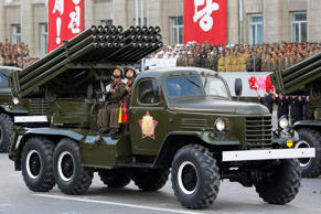 North Korean soldiers parade through Kim Il Sung Square with their missiles and rockets during a mass military parade, Saturday, Oct. 10, 2015, in Pyongyang, North Korea. North Korean leader Kim Jong Un declared Saturday that his country was ready to stand up to any threat posed by the United States as he spoke at a lavish military parade to mark the 70th anniversary of the North's ruling party and trumpet his third-generation leadership. (AP Photo/)