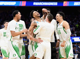 Oregon's Tyler Dorsey, center, celebrates with teammates after defeating Rhode Island 75-72 in the second round of the NCAA Tournament at Golden 1 Center on March 19, 2017 in Sacramento, Calif.