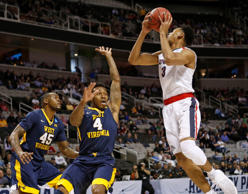 Gonzaga Bulldogs forward Johnathan Williams (3) shoots against West Virginia Mountaineers guard Daxter Miles Jr. (4) during the first half in the semifinals of the West Regional of the 2017 NCAA Tournament at SAP Center.