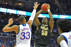 Purdue Boilermakers forward Caleb Swanigan (50) shoots over Kansas Jayhawks forward Landen Lucas (33) during the first half in the semifinals of the midwest Regional of the 2017 NCAA Tournament at Sprint Center.