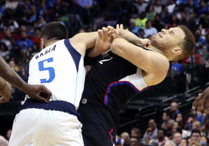J.J. Barea of the Mavericks punches Blake Griffin of the Clippers on March 23 in Dallas. J.J. Barea got ejected from the game.