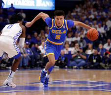 Dec 3, 2016; Lexington, KY, USA; UCLA's Lonzo Ball dribbles the ball against Kentucky's De'Aaron Fox during their meeting on Dec. 3 in Lexington, Ky.
