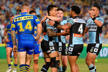 Sosaia Feki of the Sharks celebrates scoring a try with team mates during the round four NRL match between the Parramatta Eels.