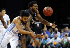 Joel Berry II of the North Carolina Tar Heels collides with Tyler Wideman of the Butler Bulldogs in the first half during the 2017 NCAA Men's Basketball Tournament South Regional at FedExForum on March 24, in Memphis.
