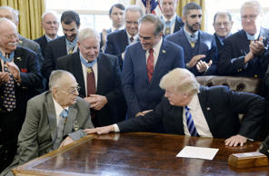 President Trump meets with Medal of Honor recipients in the Oval Office of the White House on March 24, 2017, in Washington, D.C. The meeting with decorated war heroes took place on Medal of Honor Day.