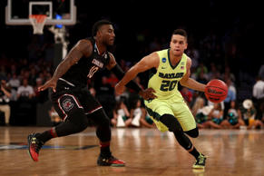 Manu Lecomte of the Baylor Bears dribbles the ball against Duane Notice of the South Carolina Gamecocks in the first half during the 2017 NCAA Men's Basketball Tournament East Regional at Madison Square Garden on March 26 in New York City.
