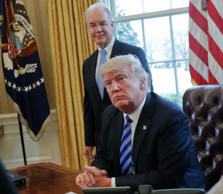President Donald Trump with Health and Human Services Secretary Tom Price, liste...