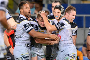 Coen Hess of the Cowboys is congratulated by team mates after scoring a try during the round four NRL match between the Gold Coast Titans and the North Queensland Cowboys.