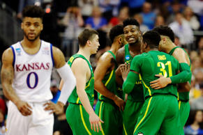 Frank Mason III #0 of the Kansas Jayhawks reacts as the Oregon Ducks celebrate their late game lead during the 2017 NCAA Men's Basketball Tournament Midwest Regional at Sprint Center on March 25, in Kansas City, Miss.