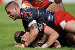 Ryan Hoffman of the Warriors is tackled by Euan Aitken of the Dragons during the round four NRL match between the St George Illawarra Dragons and the New Zealand Warriors.