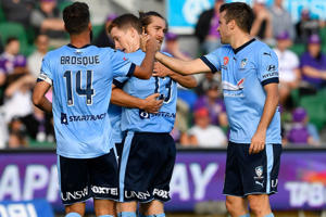 Team mates celebrate with Brandon O'Neill of Sydney FC after scoring during the round 24 A-League match between Perth Glory and Sydney FC.
