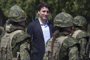 Trudeau reviews an honour guard as they arrive at the International Peacekeeping and Security Centre in Yavoriv, Ukraine, last July.