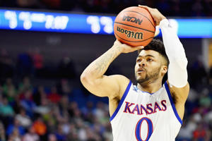 Frank Mason III #0 of the Kansas Jayhawks shoots the ball against the UC Davis Aggies during the first round of the 2017 NCAA Men's Basketball Tournament at BOK Center on March 17, in Tulsa, Okla.