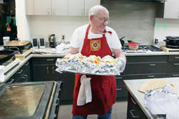 Meatball John goes around to several fire stations making meals for firefighters as they work long hours.