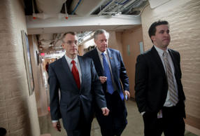 House Freedom Caucus Chairman Rep. Mark Meadows, R-N.C., center, whose conservative faction of the GOP bucked the Republican health care bill, heads to caucus meeting in the basement of the Capitol before House Speaker Paul Ryan, R-Wis., announces that he is abruptly pulling their troubled health care bill off the House floor, in Washington, Friday, March 24, 2017.