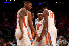 KeVaughn Allen #5 of the Florida Gators talks with his teammates in the first half against the Wisconsin Badgers during the 2017 NCAA Men's Basketball Tournament East Regional at Madison Square Garden on March 24, 2017 in New York City.