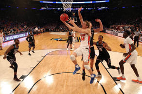 Florida Gators guard Canyon Barry (24) shoots the ball against South Carolina Gamecocks forward Maik Kotsar (21) during the first half in the finals of the East Regional of the 2017 NCAA Tournament at Madison Square Garden.