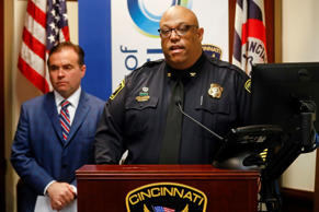 Cincinnati Police Chief Eliot Isaac speaks alongside mayor John Cranley speaks during a news conference at police headquarters regarding a fatal shooting at the Cameo Nightclub, Sunday, March 26, 2017, in Cincinnati. At least two people opened fire inside a crowded nightclub early Sunday morning, killing one person and wounding more than a dozen others in what authorities described as a chaotic scene.
