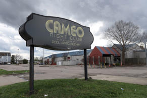 The parking lot of Cameo Nightlife club remains empty after police removed barri...