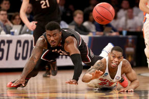 NEW YORK, NY - MARCH 26: Duane Notice #10 of the South Carolina Gamecocks and Justin Leon #23 of the Florida Gators lose the ball in the second half during the 2017 NCAA Men's Basketball Tournament East Regional at Madison Square Garden on March 26, 2017 in New York City.