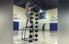 Man does handstand atop dumbbell tower