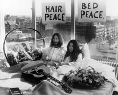 The singer John Lennon and his wife Yoko Ono holding a press conference in their bed at Amsterdam Hilton Hotel, during their honeymoon they are staying in bed for a week against war and violence in the world on March 26, 1969 in Amsterdam, Netherlands.