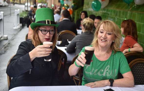 Slide 1 of 17: Customers enjoy Guiness for breakfast in the the Mercantile, Australias Longest Running Irish Pub in The Rocks in Sydney on St. Patricks Day on March 17, 2017. St. Patricks Day occurs annually on March 17 in observance of the death of St. Patrick, the pa