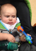 Grumpy baby not amused by toy