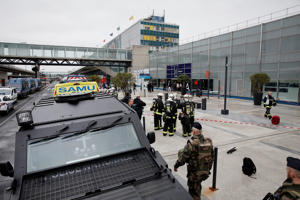 Military and emergency services outside Orly airport southern terminal after a shooting incident near Paris, France March 18, 2017.