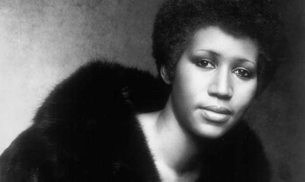 Slide 1 of 27: FEBRUARY 1974:  Soul singer Aretha Franklin poses for a portrait that appears on the album cover of her record 'Let Me In You Life' which was released in February 1974. (Photo by Michael Ochs Archives/Getty Images)