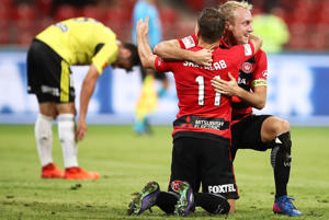 Brendon Santalab of the Wanderers celebrates with team mate Mitch Nichols after scoring his second goal during the round 23 A-League.