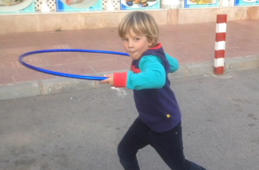 Boy with funny hula hoop style